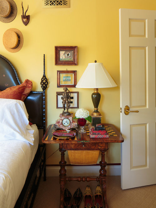 Inspiration for a mediterranean bedroom remodel in Other with yellow walls