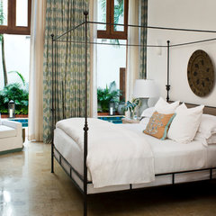 tropical bedroom by KS McRorie Interior Design