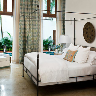 Inspiration for a tropical bedroom remodel in Atlanta with white walls