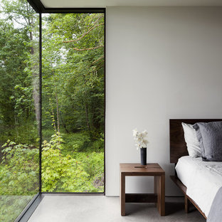 Inspiration for a modern bedroom in Seattle with white walls.