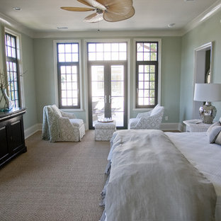 Example of a coastal bedroom design in Charleston with green walls