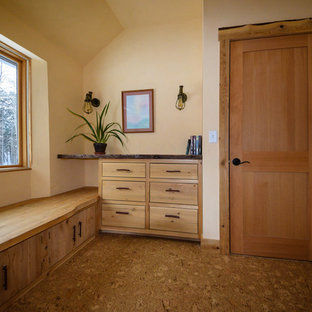 Photo of a small arts and crafts guest bedroom in Burlington with yellow walls, cork floors and beige floor.
