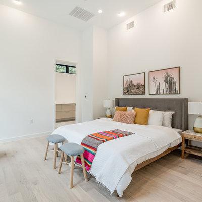 Bedroom - mid-sized scandinavian master light wood floor and beige floor bedroom idea in Austin with white walls and no fireplace