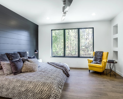 Trendy Guest Medium Tone Wood Floor And Brown Floor Bedroom Photo In Grand  Rapids With White