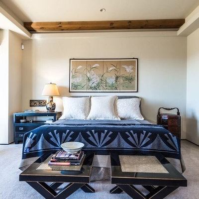 Inspiration for a mid-sized rustic master carpeted bedroom remodel in Other with beige walls and no fireplace