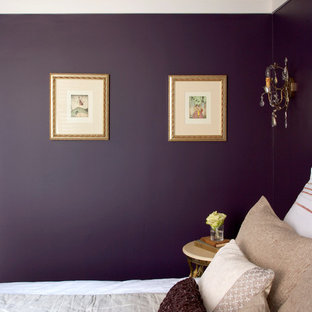 This is an example of an expansive traditional guest bedroom in New York with purple walls and medium hardwood flooring.