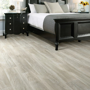 Inspiration for a large timeless master ceramic tile and beige floor bedroom remodel in San Francisco with gray walls and a hanging fireplace