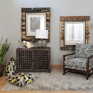 Large eclectic guest limestone floor and beige floor bedroom photo in Phoenix with gray walls