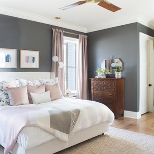 Bedroom - mid-sized transitional master light wood floor bedroom idea in Other with gray walls