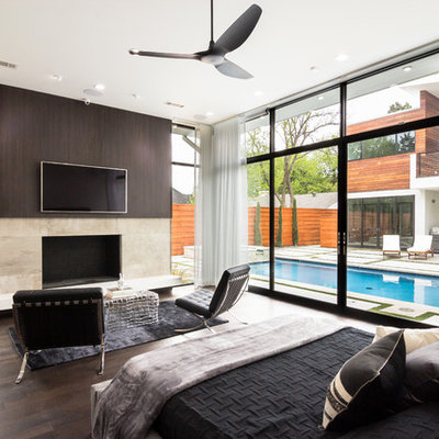 Inspiration for a large contemporary master dark wood floor and brown floor bedroom remodel in Dallas with a standard fireplace and a tile fireplace
