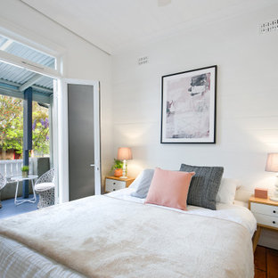 Design ideas for a transitional bedroom in Sydney with white walls, dark hardwood floors and brown floor.