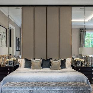 Traditional master bedroom in Berkshire with beige walls, carpet and beige floors.