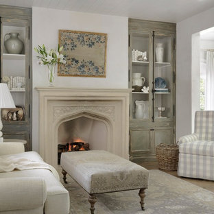 Example of a cottage chic master medium tone wood floor bedroom design in St Louis with a standard fireplace