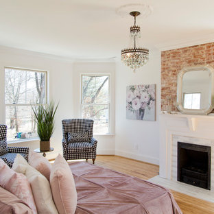 Inspiration for a large shabby-chic style master medium tone wood floor and brown floor bedroom remodel in St Louis with white walls, a standard fireplace and a tile fireplace