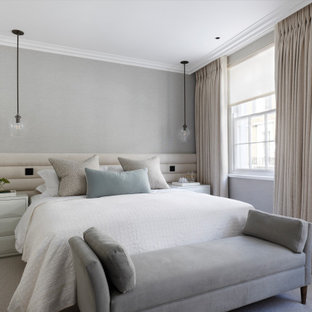Traditional bedroom in London with grey walls, carpet and grey floors.