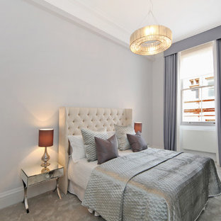 Inspiration for a large transitional carpeted and gray floor bedroom remodel in London with gray walls