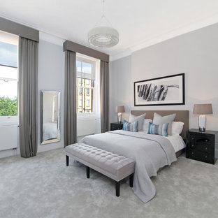 Large Classic Bedroom In London With Grey Walls, Carpet And Grey Floors.
