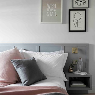 Design ideas for a mid-sized contemporary bedroom in London with white walls.
