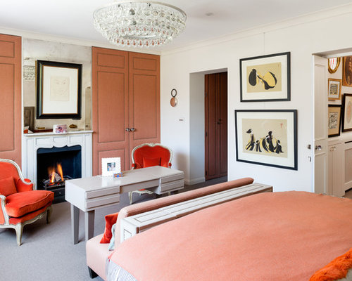 Photo Of A Contemporary Bedroom In London With White Walls, Carpet And A  Standard Fireplace