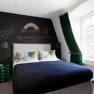 Design ideas for a contemporary guest bedroom in London with black walls and carpet.