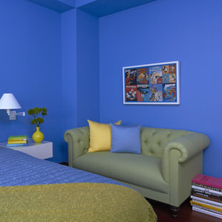 Example of a mid-sized eclectic guest medium tone wood floor bedroom design in New York with blue walls