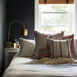 Example of a small eclectic master bedroom design in New York with blue walls