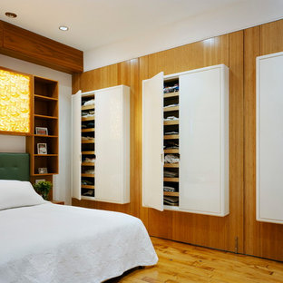 Bedroom - contemporary medium tone wood floor bedroom idea in New York
