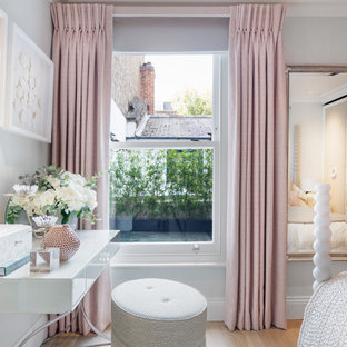 Photo of a medium sized traditional bedroom in London with grey walls, light hardwood flooring and brown floors.