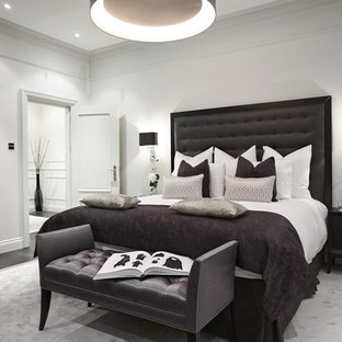 Inspiration for a classic bedroom in London with white walls and dark hardwood flooring.