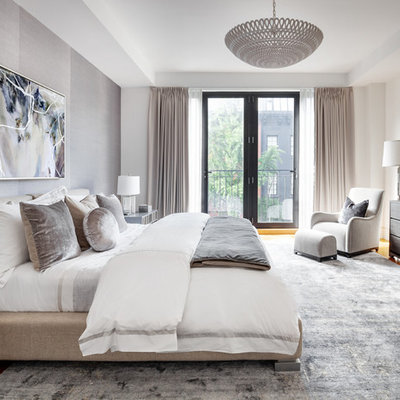 Danish master medium tone wood floor bedroom photo in New York with gray walls and no fireplace