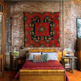 Bedroom - eclectic medium tone wood floor bedroom idea in New York