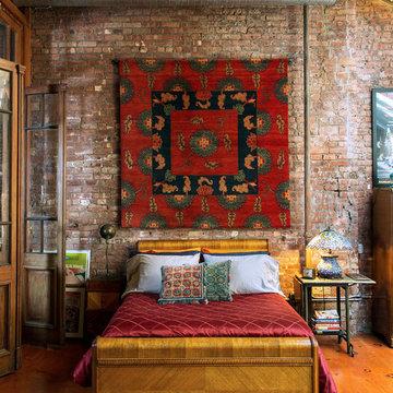 """Chenden"" Ralo handmade rug hanging in actor B.D. Wong's loft"