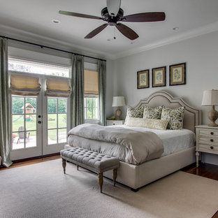 Inspiration for a mid-sized timeless master medium tone wood floor bedroom remodel in Nashville with gray walls and no fireplace