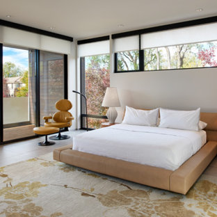 Large trendy master porcelain floor and gray floor bedroom photo in Denver with white walls and no fireplace