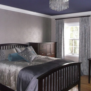 Bedroom - large contemporary master light wood floor bedroom idea in Toronto with purple walls
