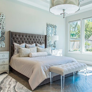 Large modern master bedroom in Houston with grey walls, no fireplace and porcelain floors.