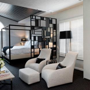 Idées déco pour une chambre contemporaine de taille moyenne avec un mur blanc et aucune cheminée.