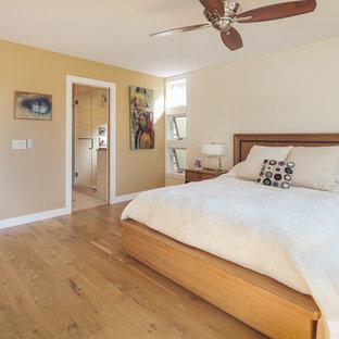 Example of a trendy master medium tone wood floor bedroom design in Chicago with beige walls
