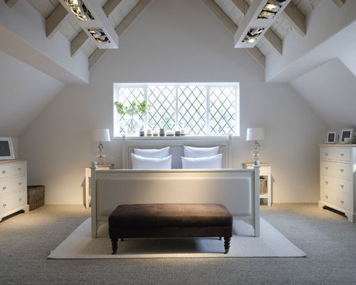 Example Of A Transitional Bedroom Design In London With Carpet