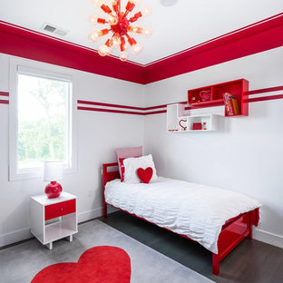 Modern master bedroom in New York with red walls and dark hardwood floors.