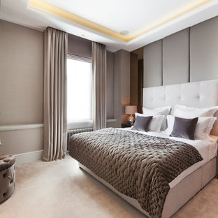 Design ideas for a medium sized traditional master bedroom in London with carpet, beige floors, beige walls and no fireplace.