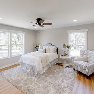 Mid-sized cottage master laminate floor and brown floor bedroom photo in Sacramento with gray walls
