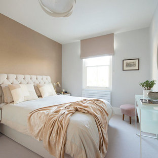 Contemporary master bedroom in London with white walls, carpet and grey floors.