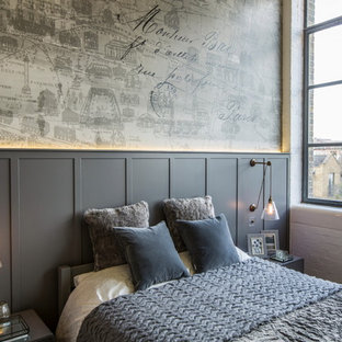 Design ideas for a large urban master bedroom in London with grey walls.