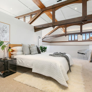 Inspiration for a large contemporary loft-style bedroom in Hobart with white walls, carpet and beige floor.