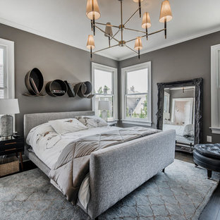 Example of a large transitional master dark wood floor and black floor bedroom design in Columbus with gray walls and no fireplace