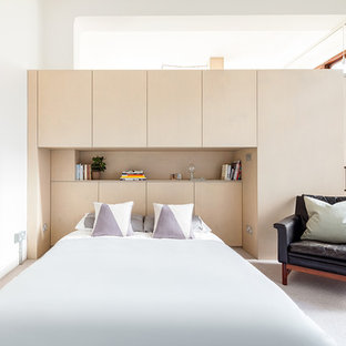Inspiration for a small contemporary master bedroom in London with white walls, carpet and grey floors.