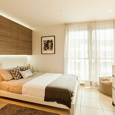 Small trendy master porcelain tile bedroom photo in Other with gray walls and no fireplace