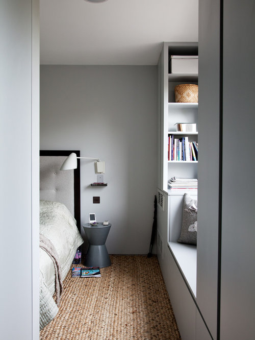 Minimalist bedroom photo in London with gray walls