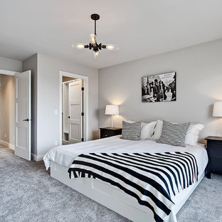 Inspiration for a classic master bedroom in Calgary with grey walls and carpet.